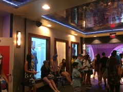 Planet Hollywood Disney Springs entrance hall with 4 transparent Displays